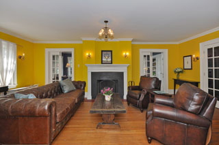 Living Room With Yellow Walls and Leather Furniture