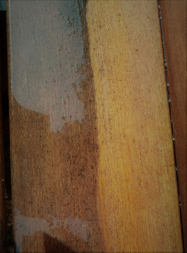 Closeup of sun and water damaged pressure treated wood