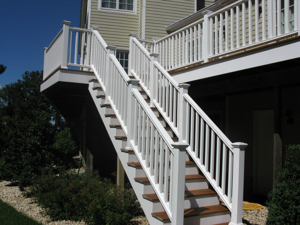 White Railing on Both Sides of Stairs From Outside Balcony