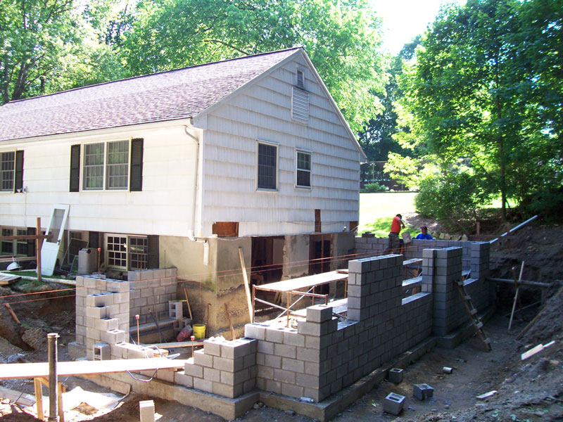 Cinder Block Foundation for Addition on White Ranch Style Home