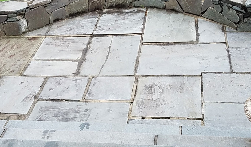 Water damaged mortar cracks in flagstone