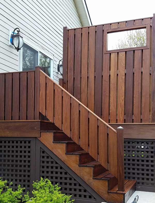 Wood stairs, railing and fence after pressure washing and brown stain. Looks like new.